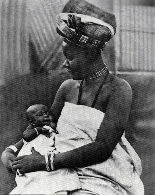 Mother and child Bamun Kingdom, Cameroon Princess Ngutane cradles her firstborn son, Amidou Mounde, who was born in 1915 Photograph - Horniman Museum London